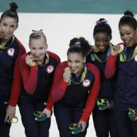 Dominant U.S. women give Karolyi golden farewell; Japan finishes fourth