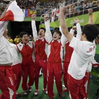 Japan men's gymnastics team strikes gold over Russia, China