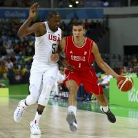 Serbia takes U.S. down to wire in loss