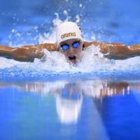 Hosszu earns long-awaited medal in record fashion