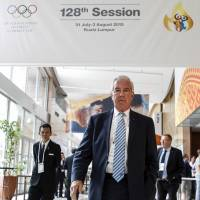 WADA chief Reedie hits back at Bach on Russia doping row