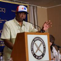Former Montreal Expos player Warren Cromartie speaks at the Foreign Correspondents' Club of Japan on Monday in Tokyo. Cromartie, who became a star with the Yomiuri Giants, is trying to help Montreal get an MLB franchise again. | JASON COSKREY