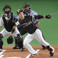The Hawks' Kenta Imamiya hits a home run during the first inning of Softbank's victory over Nippon Ham on Friday in Sapporo. | KYODO
