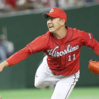 Carp starter Yuya Fukui pitches against the Giants on Wednesday at Tokyo Dome. | KYODO
