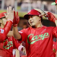 Carp clobber BayStars to clinch postseason berth