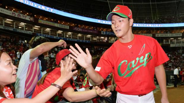 Rookie Yabuta helps Carp move closer to pennant