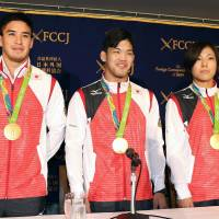 Judo gold medalists Mashu Baker (left), Shohei Ono (center) and Haruka Tachimoto pose during a news conference at the Foreign Correspondents' Club of Japan on Tuesday. | KYODO