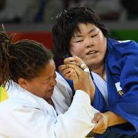 Turkey's Kayra Sayit (left) competes with Japan's Kanae Yamabe during their women's over 78 kg judo contest bronze medal A match of the Rio 2016 Olympic Games in Rio de Janeiro on Friday. | AFP-JIJI