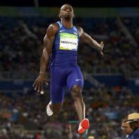 Long jump champion Henderson exhibits poise, flair for dramatic