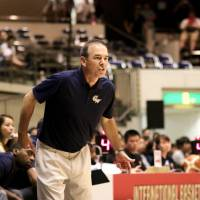 George Washington head coach Mike Lonergan gives instructions to his players during an August 16 game against the Japanese men's national team at Ryogoku Kokugikan. | KAZ NAGATSUKA