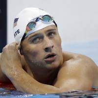 Lochte back home before Rio judge ordered him to stay put but two other U.S. swimmers taken off plane: reports