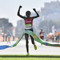 Kenya's Jelagat Sumgong crosses the finish line to capture gold in the marathon at the 2016 Olympics on Sunday in Rio de Janeiro. | AFP-JIJI