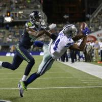 Romo gives Cowboys scare in loss to Seattle