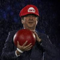 Prime Minister Shinzo Abe is seen on stage after entering the venue dressed as the video game character Mario at the 2016 Summer Olympics closing ceremony in Rio de Janeiro on Sunday. | REUTERS