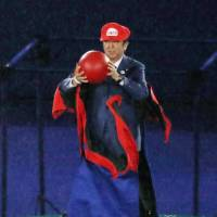 Prime Minister Shinzo Abe enters the venue dressed as the video game character Mario at the 2016 Summer Olympics closing ceremony in Rio de Janeiro on Sunday. | KYODO