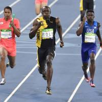 Japan's Aska Cambridge (left), seen racing against Jamaica's Usain Bolt (center) and Trayvon Bromell of the United States in the men's 4x100-meter relay final on Friday at the Rio Olympics, has helped raised expectations for Japan's relay squad for the 2020 Tokyo Games. Cambridge and teammates Ryota Yamagata, Shota Iizuka and Yoshihide Kiryu delivered a silver medal-winning performance in Rio de Janeiro. | AP