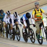 Cyclists follow Rio Olympic volunteer Ivo Siebert on the electric bike at the start of a women's keirin first-round race in Rio de Janeiro on Friday. | REUTERS