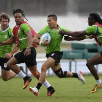 South Africa's Cheslin Kolbe runs with the ball during an Olympic rugby sevens practice session in Rio de Janeiro on Wednesday. | AP