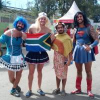 Fans pose for a photo outside Deodoro Stadium at the rugby sevens tournament at the Rio Olympics on Thursday. | ANDREW MCKIRDY