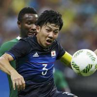 Weary Nigeria outscores Japan in opening match