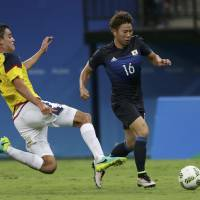 Nakajima's strike salvages draw against Colombia