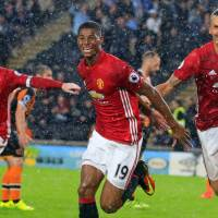 Rashford strikes late to lift United to win over Hull