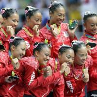 Japan nabs bronze in team synchro