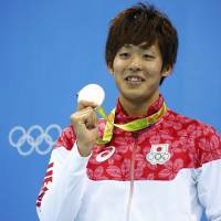 Masato Sakai poses with his silver medal after the men's 200-meter butterfly final on Tuesday. | REUTERS