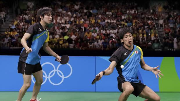 Japan settles for silver in  team table tennis
