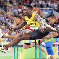 McLeod races to gold in 110 hurdles