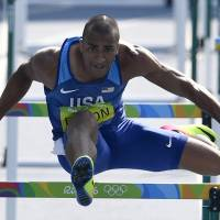 Ashton Eaton of the United States competes in the decathlon 110-meter hurdles on Thursday. Eaton won the event for the second straight Olympics. | AP