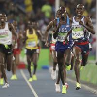 Mo Farah leads the field in the men's 5,000-meter final on Saturday at the Summer Olympics in Rio de Janeiro. Farah won to complete the double-double. | AP