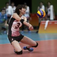 Japan captain Saori Kimura digs the ball during Friday's match against Russia at the Rio Olympics. Russia won 25-14, 30-28, 25-18. | REUTERS