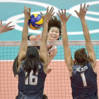 Japan's Saori Kimura has her spike blocked by the U.S. team during their quarterfinal match at the 2016 Summer Games on Tuesday in Rio de Janeiro. | KYODO