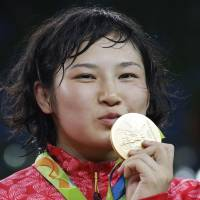 Japan's Sara Dosho, gold medalist, poses during the medals ceremony for the women's wrestling freestyle 69-kg competition at the 2016 Summer Olympics in Rio de Janeiro Wednesday. | AP