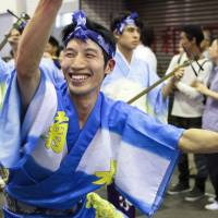 Day pass: A member of the Kikusuiren troupe performs the Awa odori, a dance that resembles the moves of a drunken fisherman.   JAMES HADFIELD