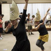 Getting ready: Dancers from the Maichoren troupe practice for this year's Tokyo Koenji Awa Odori festival.   JAMES HADFIELD