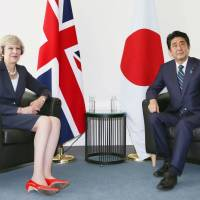 May vows to help Japanese firms in meeting with Abe