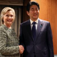 Prime Minister Shinzo Abe meets with U.S. Democratic presidential candidate Hillary Clinton at a hotel in New York on Monday. | REUTERS