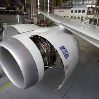 The Rolls Royce Holdings PLC logo is displayed on an engine of a Boeing Co. 787-9 Dreamliner at Air New Zealand's technical operations base at Auckland International Airport in 2014. | BLOOMBERG