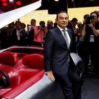 Carlos Ghosn, chairman and CEO of the Renault-Nissan Alliance, poses at a news conference on media day at the Paris auto show in France on Thursday. | REUTERS