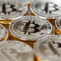 A U.S. federal judge has ruled that bitcoin qualifies as money in a decision linked to a criminal case over hacking attacks against a major bank and other companies. | BLOOMBERG