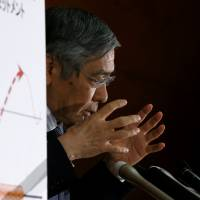 Bank of Japan Gov. Haruhiko Kuroda attends a news conference at BOJ headquarters in Tokyo on Wednesday. | REUTERS