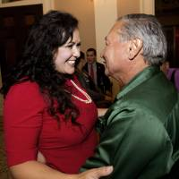 Assemblywoman Lorena Gonzalez, D-San Diego, receives congratulations from Arturo Rodriguez, president of the United Farm Workers, after the assembly approved her bill requiring farmworkers to receive overtime pay after working eight hours, at the Capitol in Sacramento Monday. | AP