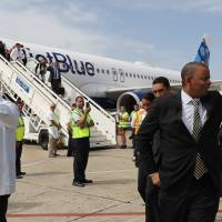Cuba welcomes first U.S. commercial flight in 55 years, braces for tourist flood