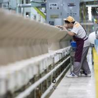 Lixil Group Corp. Inax porcelain toilet bowls are inspected before finishing at the company's Enokido plant in Tokoname, Aichi Prefecture, on Sept. 9. | BLOOMBERG