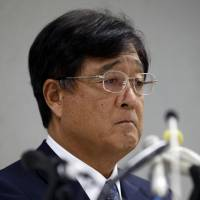 Mitsubishi Motors Corp. Chairman Osamu Masuko listens to a reporter's question during a news conference at the troubled automaker's headquarters in Tokyo on Aug. 2. | AP
