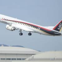 A Mitsubishi Regional Jet takes off from Nagoya Airport on Monday. | KYODO