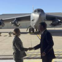 With a B-52 in the background, Defense Secretary Ash Carter greets airmen at Minot Air Force Base, North Dakota, Monday, after giving a speech on nuclear weapons. Carter says the Pentagon is committed to correcting what he calls decades of shortchanging its nuclear forces. | AP