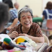 Signs of graying Japan: pensioners in the gym and a shortage of denture experts